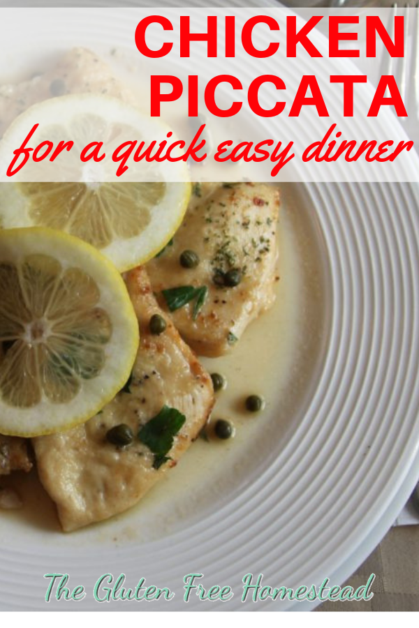 chicken piccata on a white plate with lemon and capers